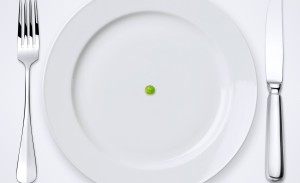 One Green Pea On Plate. Table Setting With Clipping Path.